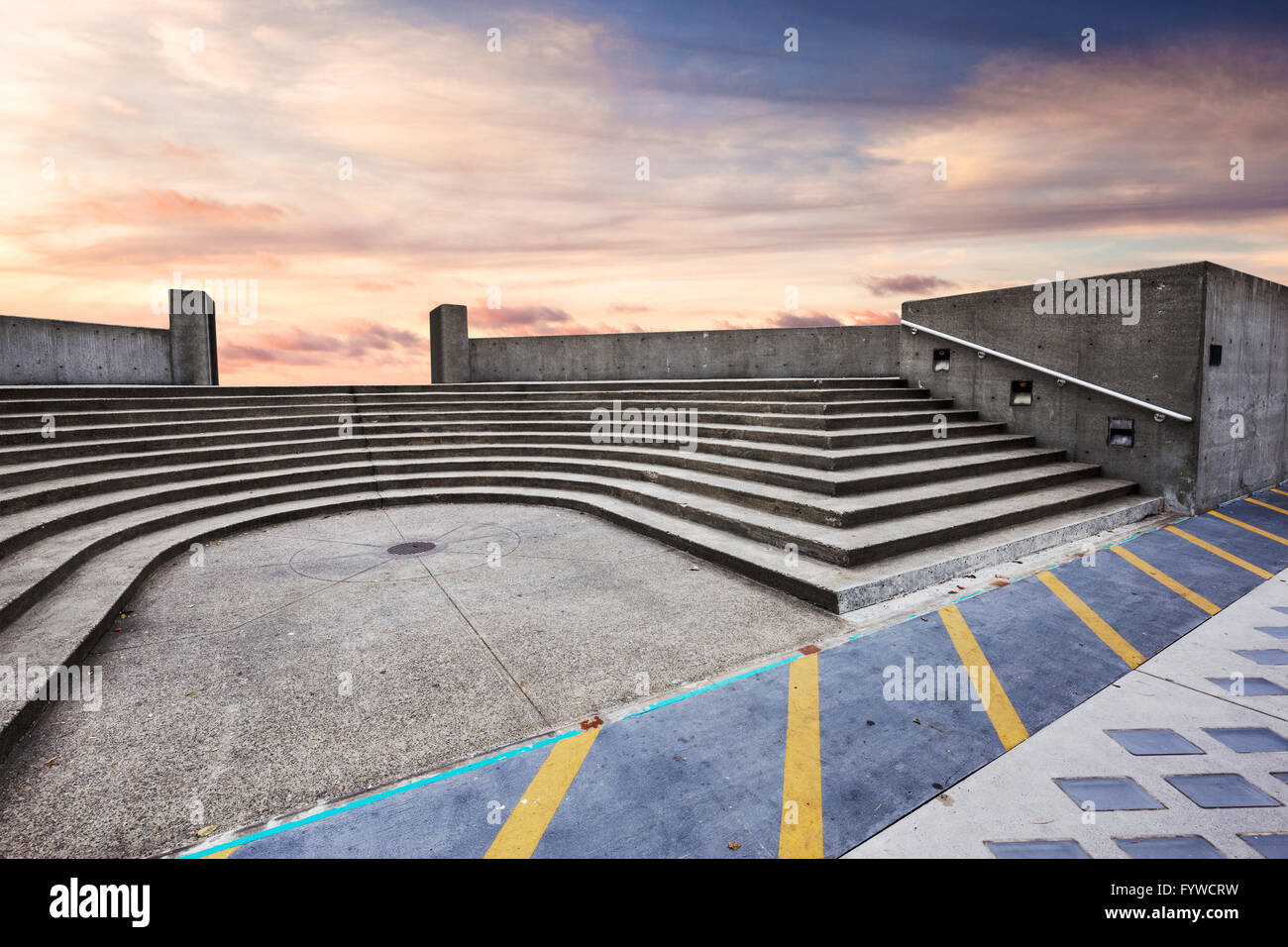 skyscape on view of empty ground with steps - Stock Image