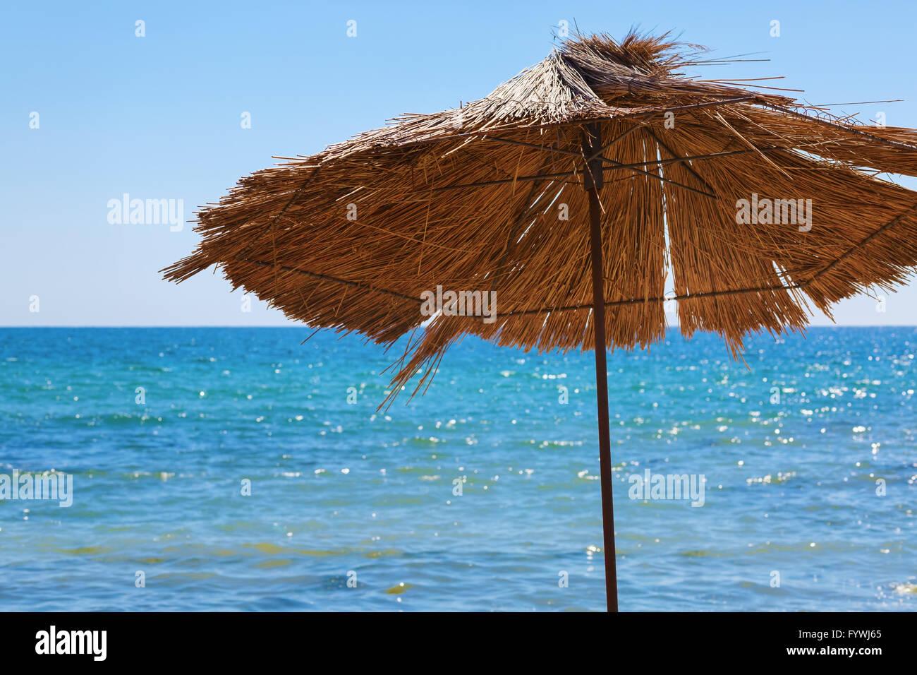 Straw umbrella - Stock Image