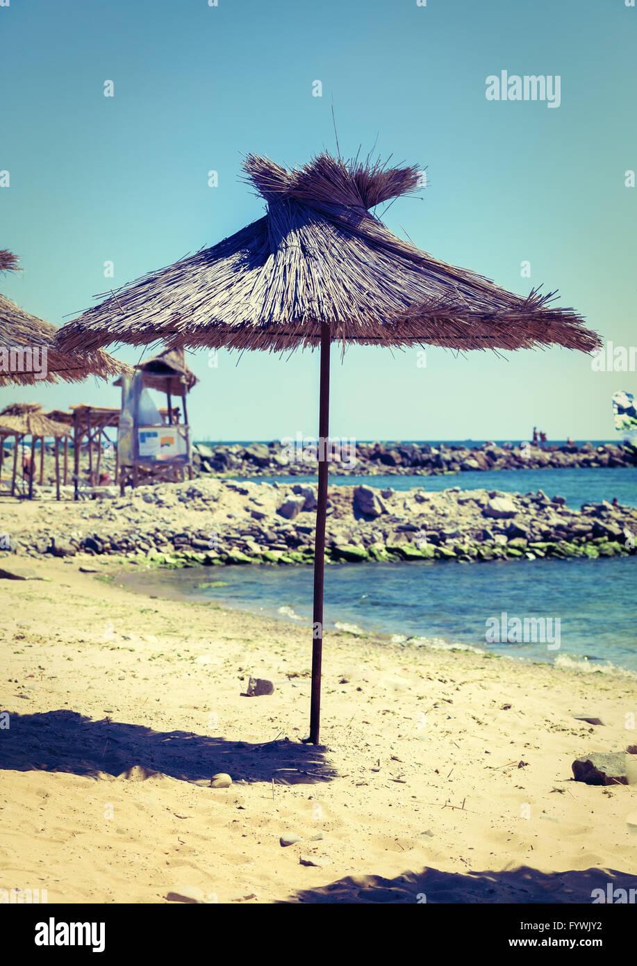 Beach straw umbrella - Stock Image