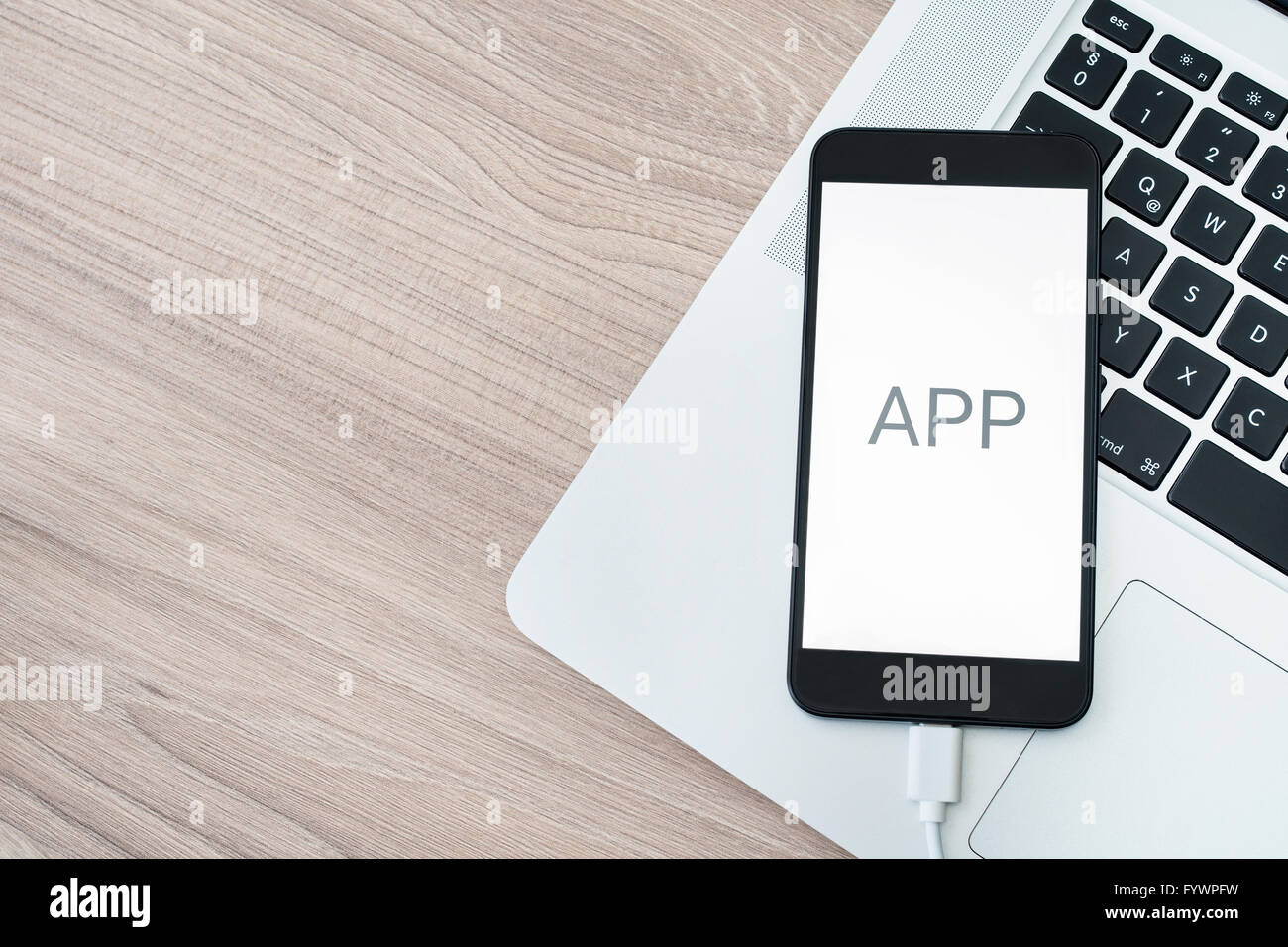 Mobile application development with computer and smartphone - Stock Image