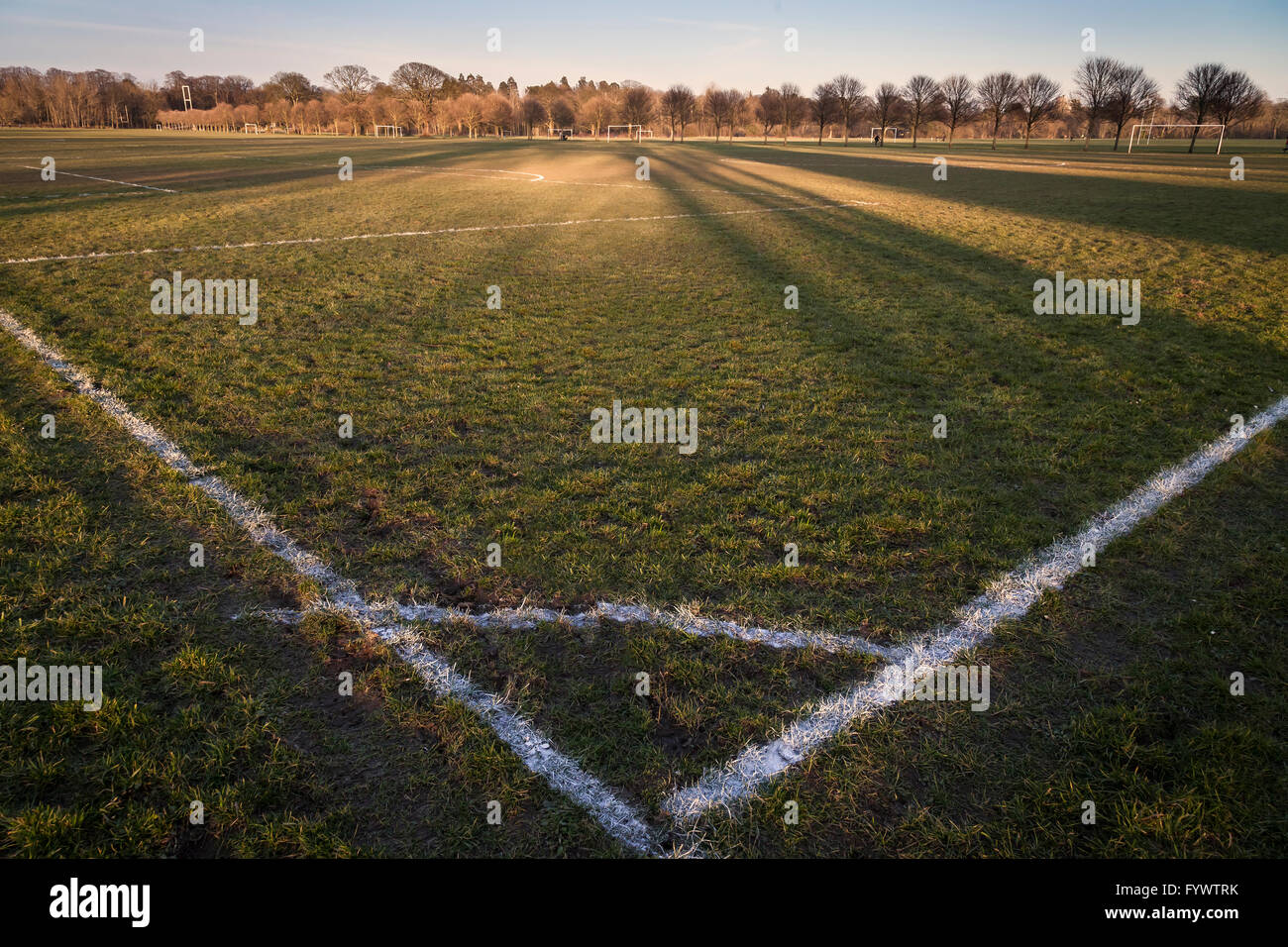 Sunset and shadows over a football pitch in Cardiff, UK Stock Photo