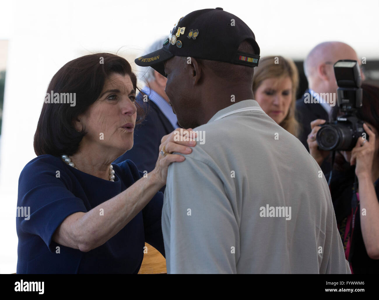 Luci Baines Johnson, daughter of Pres. Lyndon Johnson, speaks with a veteran during the Vietnam War Summit at the Stock Photo