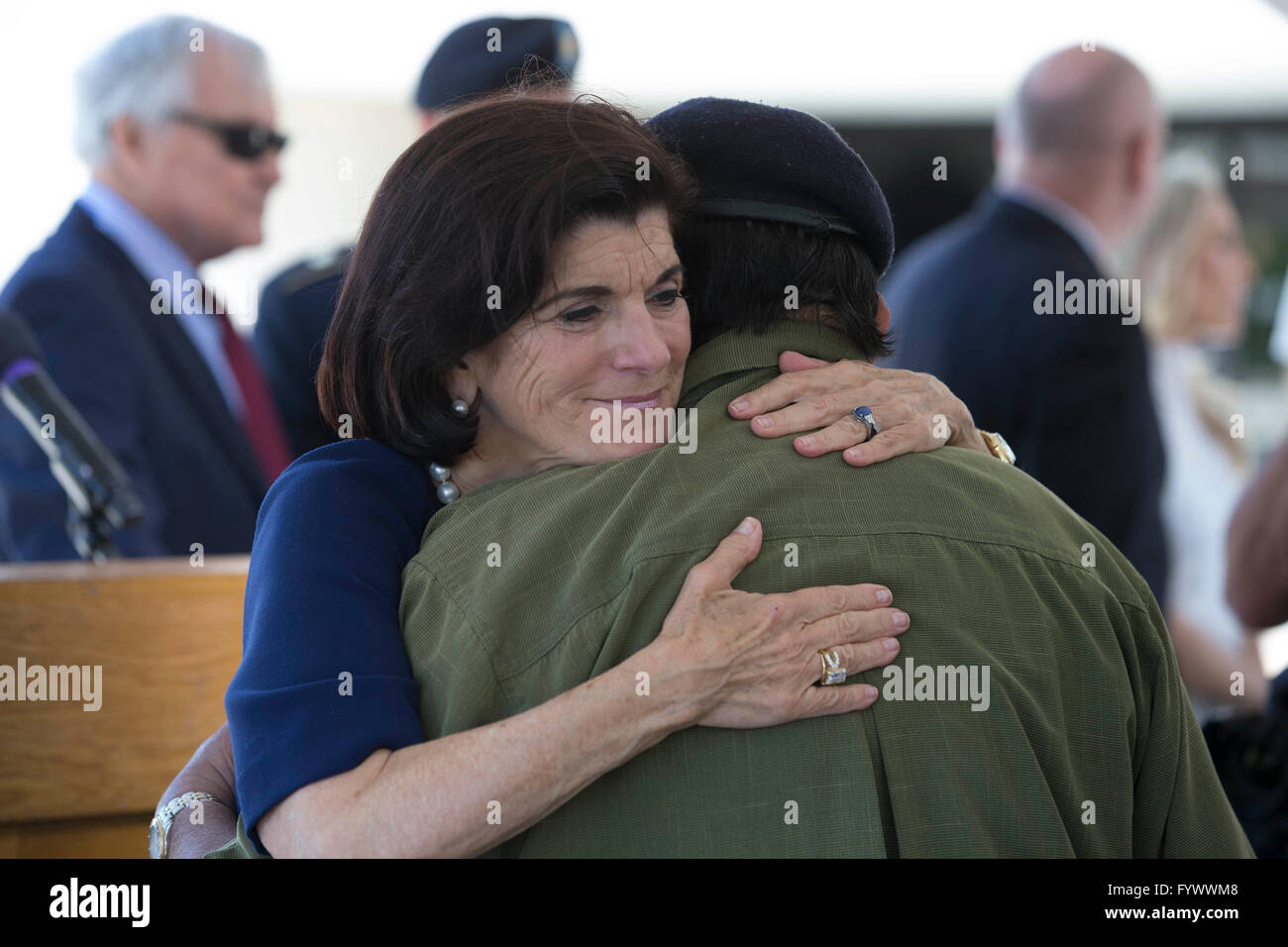 Luci Baines Johnson hugs Vietnam veteran Ignacio Perez during the second day of the Vietnam War Summit at the LBJ Stock Photo