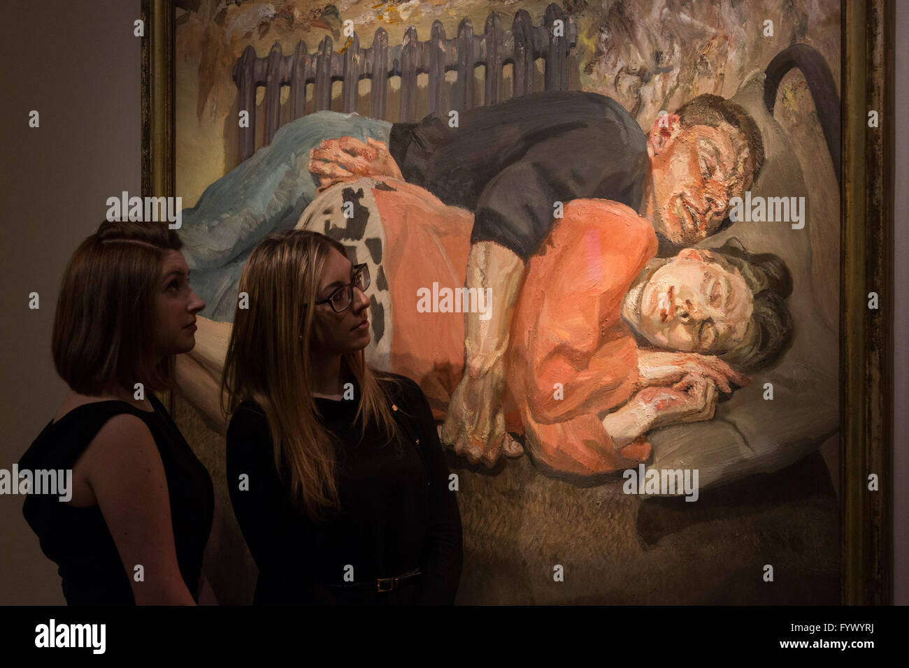 London, UK. 28 April 2016. Christie's employees look at the painting Ib and Her Husband, 1992, by Lucian Freud, - Stock Image
