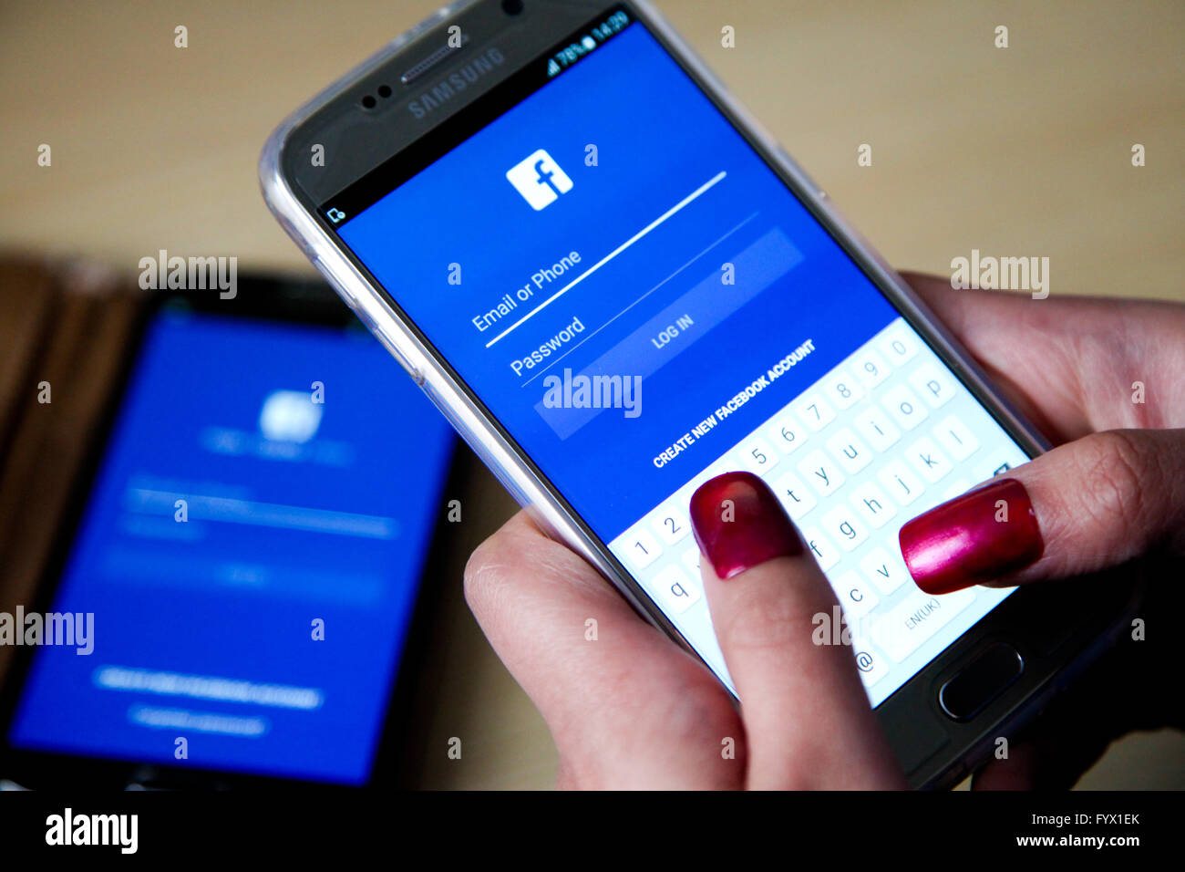 Facebook On Samsung Phone Stock Photos & Facebook On ...