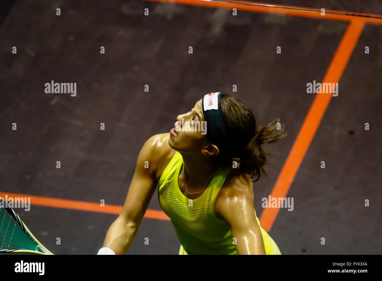 Kuala Lumpur, Malaysia. 28th Apr, 2016. Nicol David running fast to return a shot at Women's World Championships - Stock Image