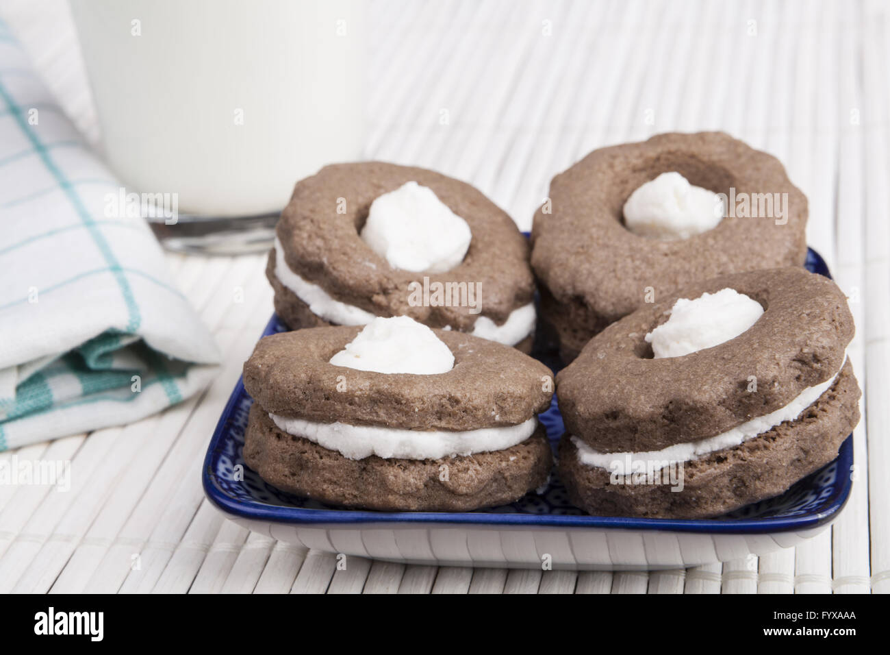 Four Cookies and Milk - Stock Image