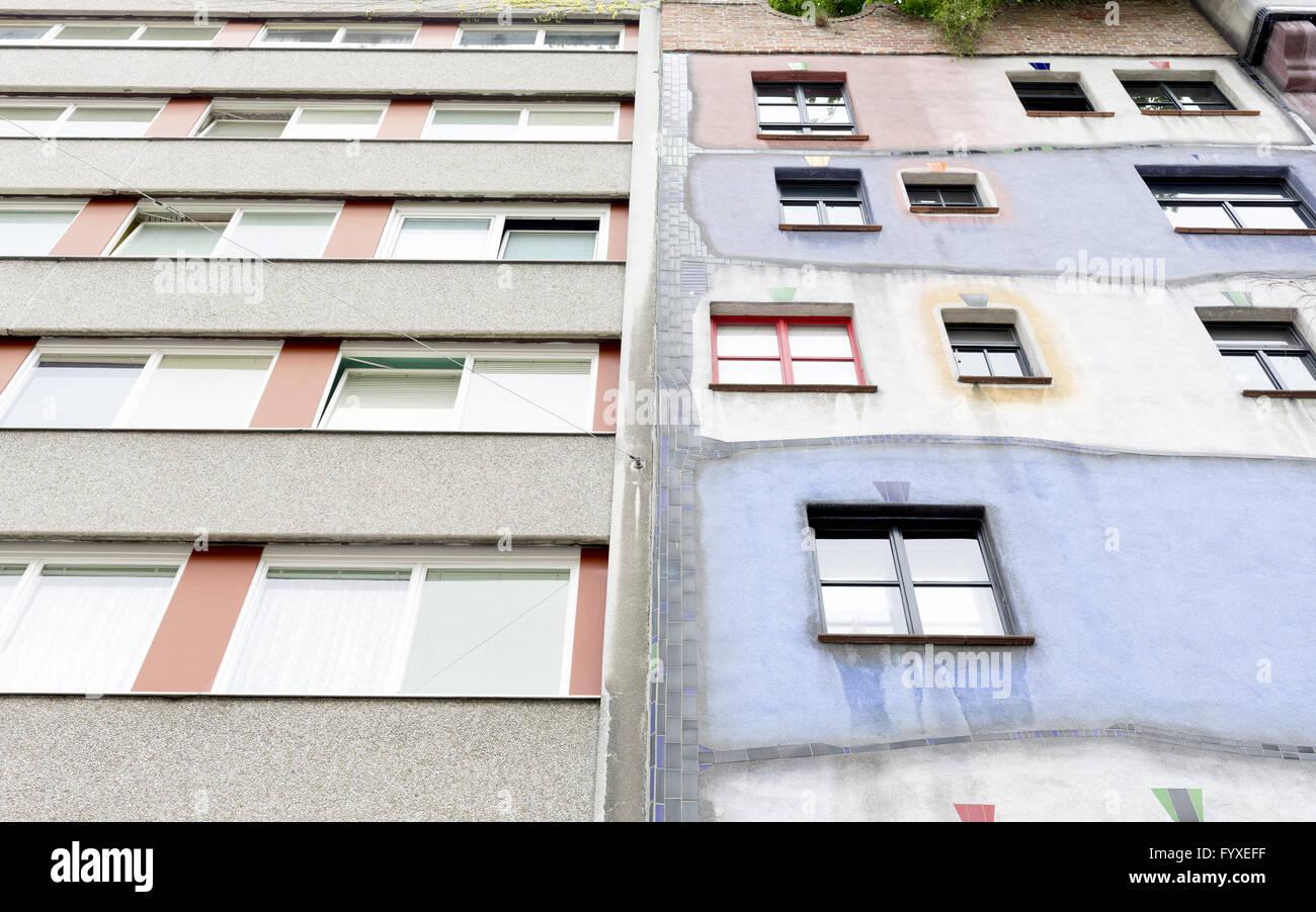 Hundertwasser House vs ordinary house - Stock Image