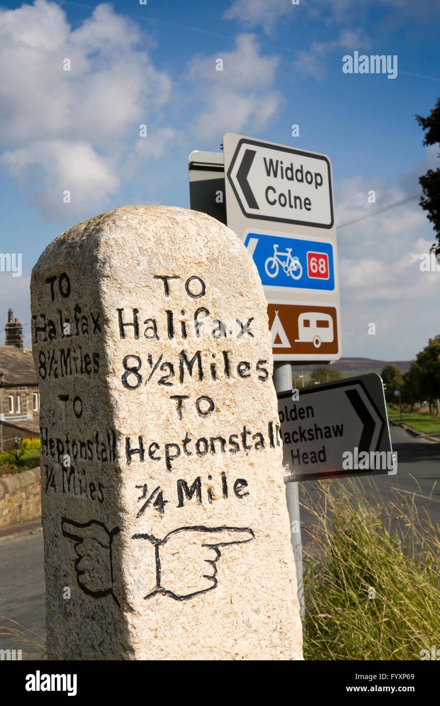 UK, England, Yorkshire, Calderdale, Slack, old white painted finger pointing milestone to Halifax and Heptonstall - Stock Image