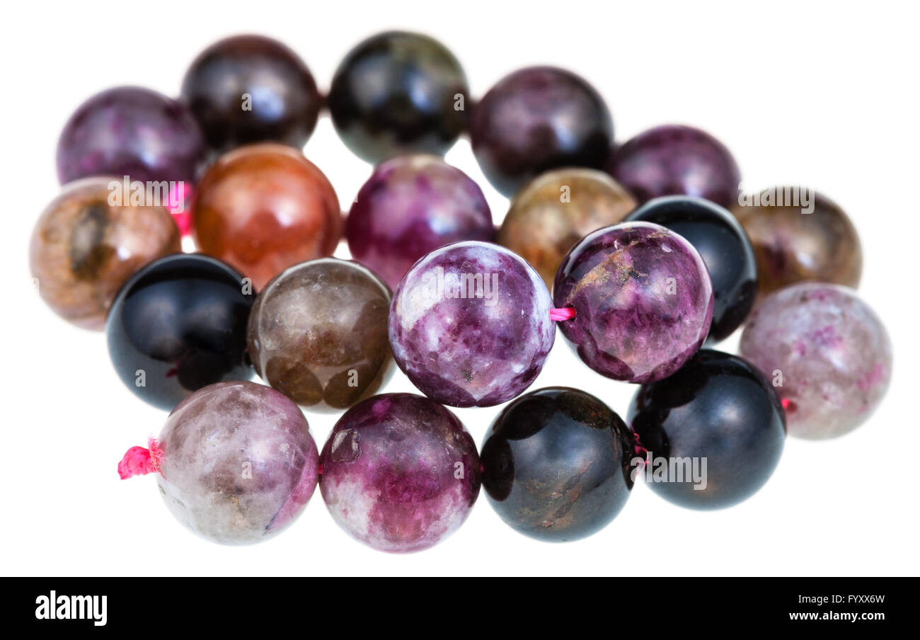 string of beads from natural mineral gemstones - tourmaline balls isolated on white background - Stock Image