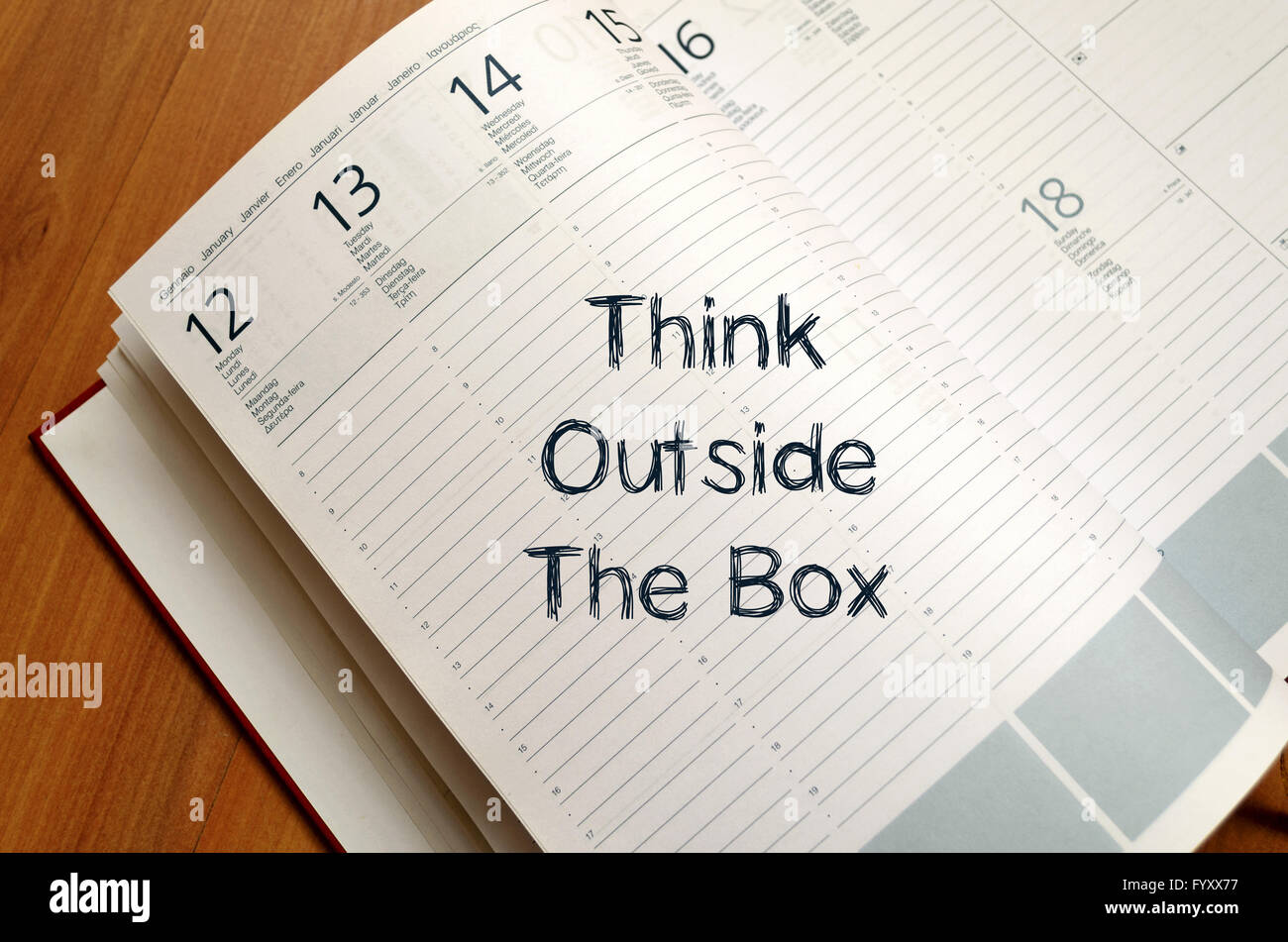 Think outside the box write on notebook - Stock Image