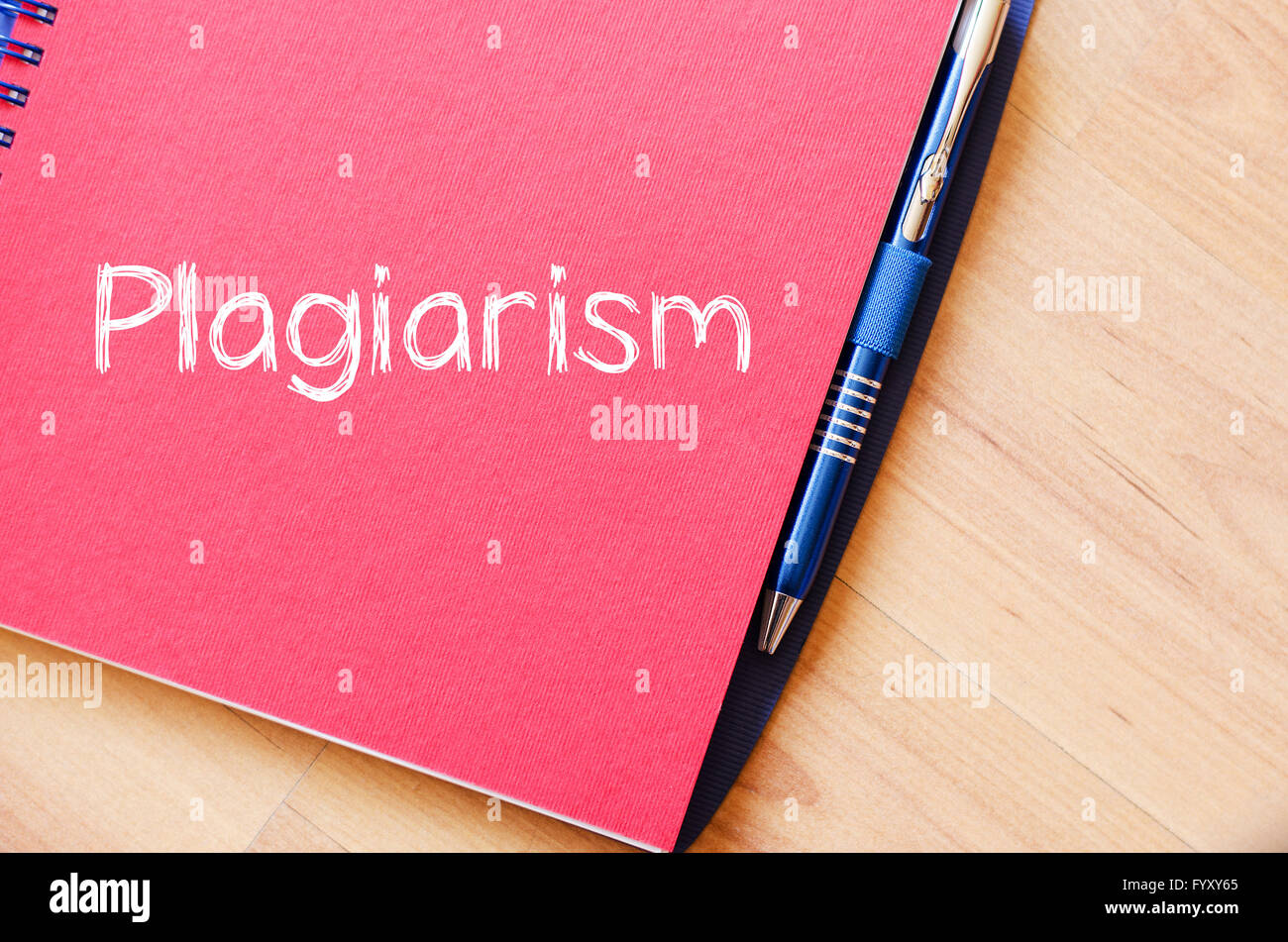 Plagiarism write on notebook - Stock Image