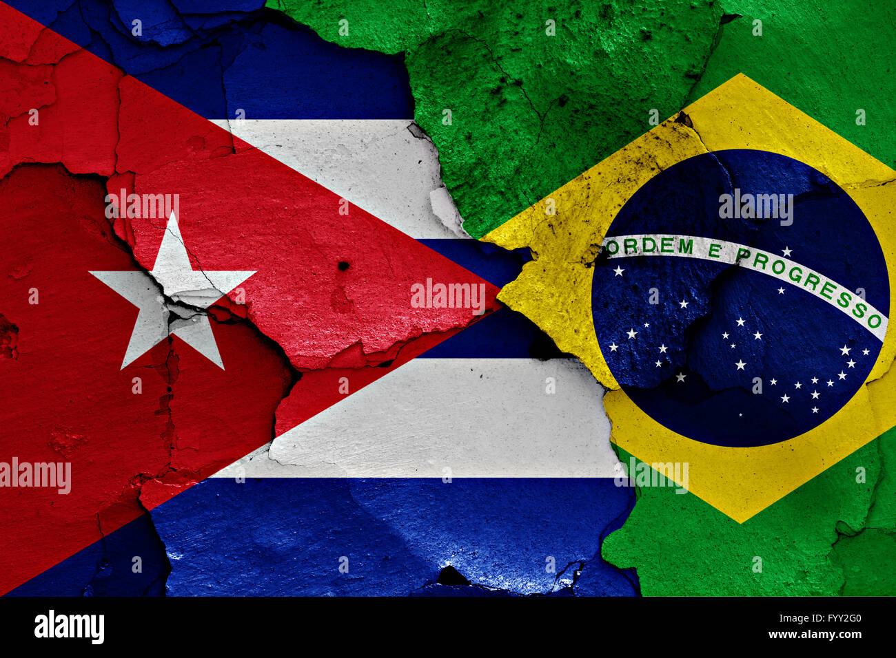 flags of Cuba and Brazil painted on cracked wall - Stock Image