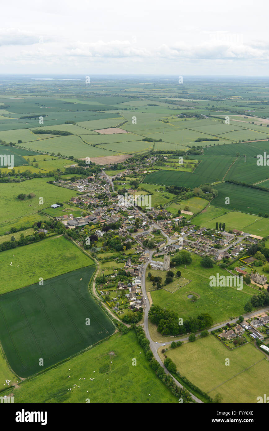An aerial view of the village of Titchmarsh and surrounding Northamptonshire countryside - Stock Image