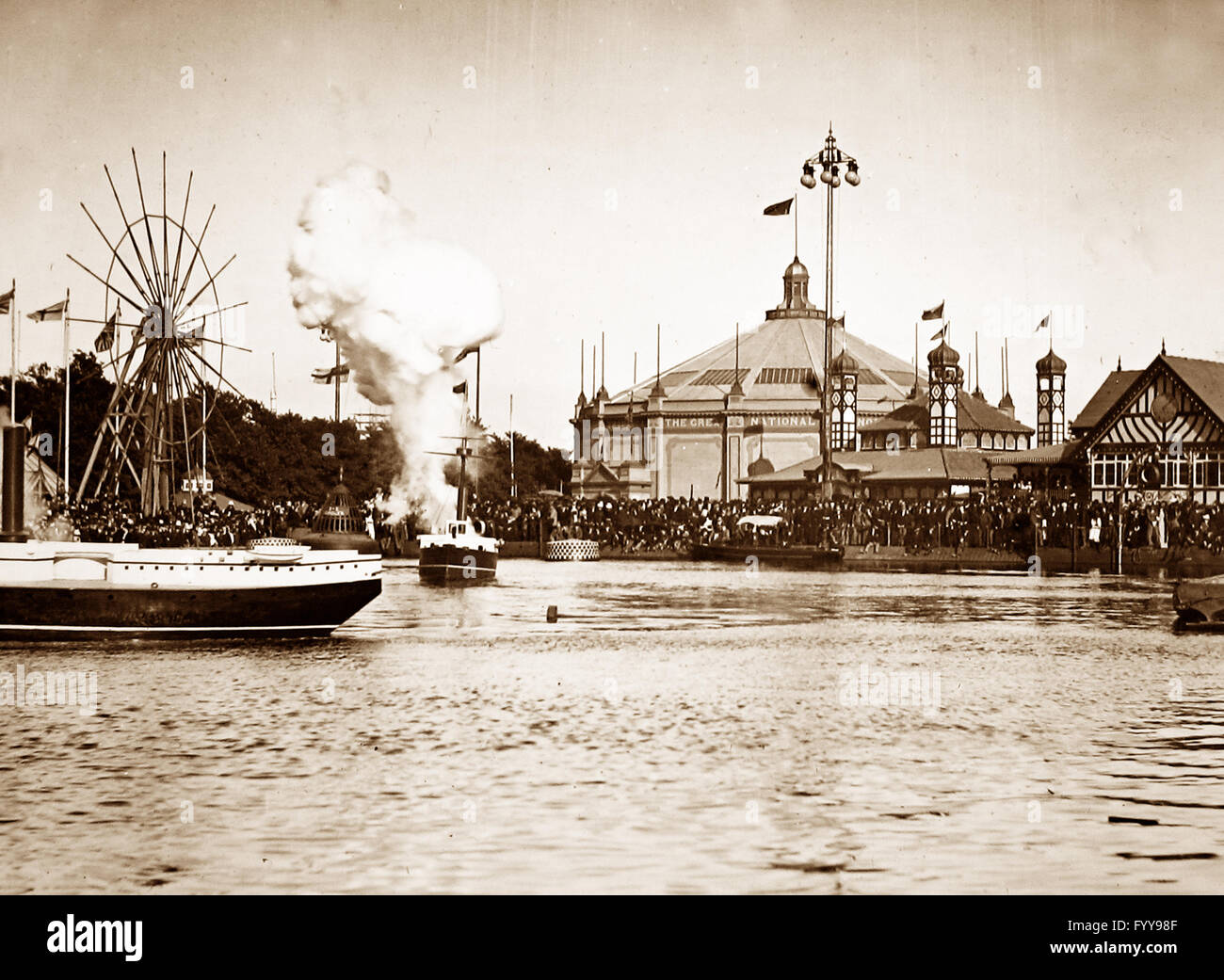 Royal Naval Exhibition 1891 - battleships in action - Stock Image