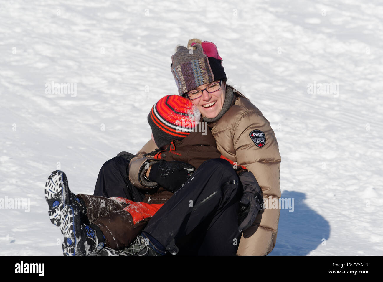 Mother and Son (4 years old)  sledging in Quebec Canada - Stock Image