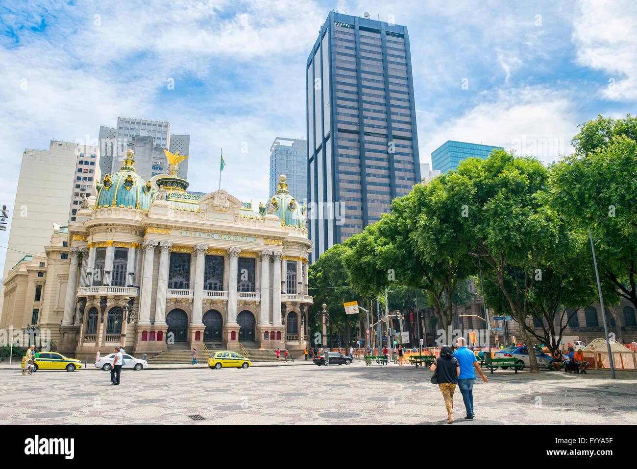 RIO DE JANEIRO - FEBRUARY 26, 2016: Pedestrians and traffic pass the Municipal Theatre, built in an Art Nouveau Stock Photo