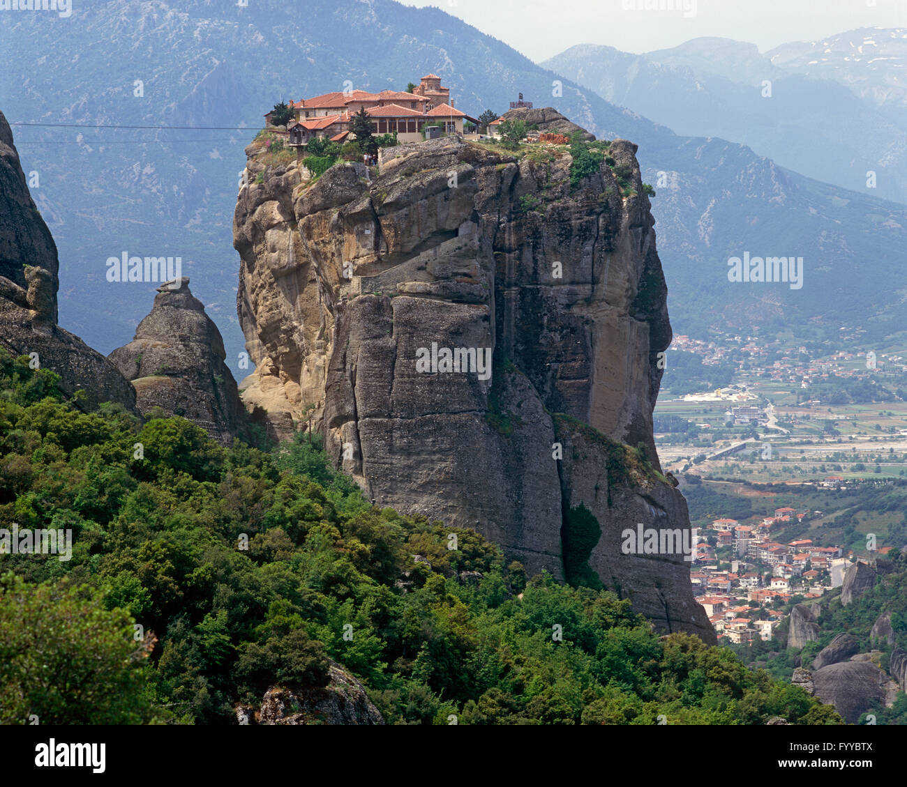 Houses on  a tall rocky hill, outside - Stock Image