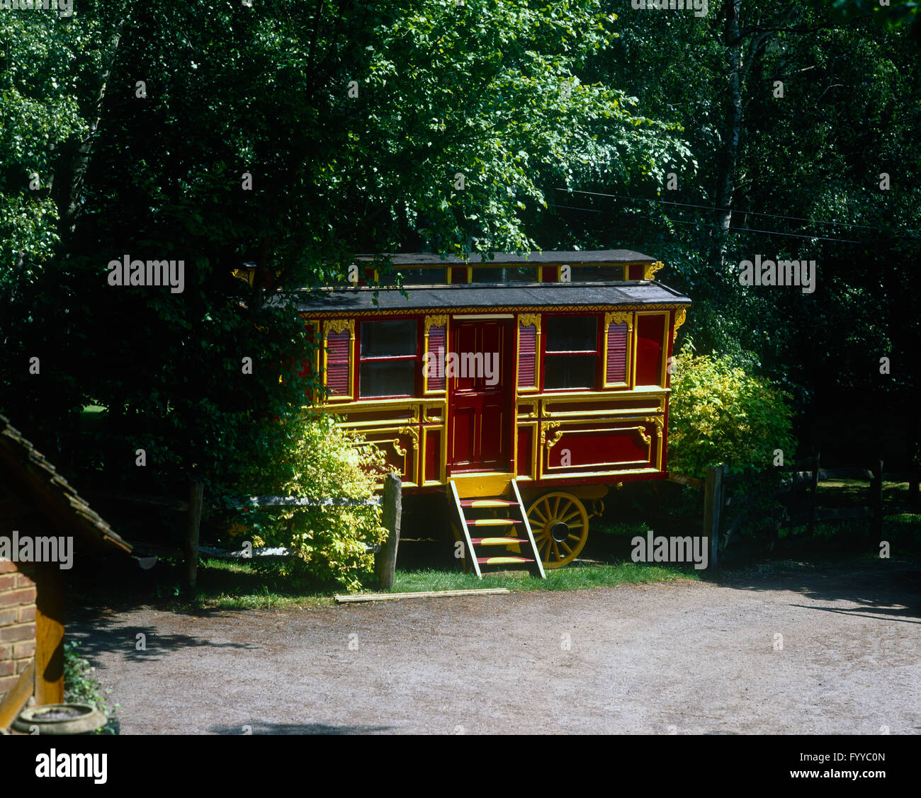 Fortune teller caravan tucked into the trees and bushes, outside. - Stock Image