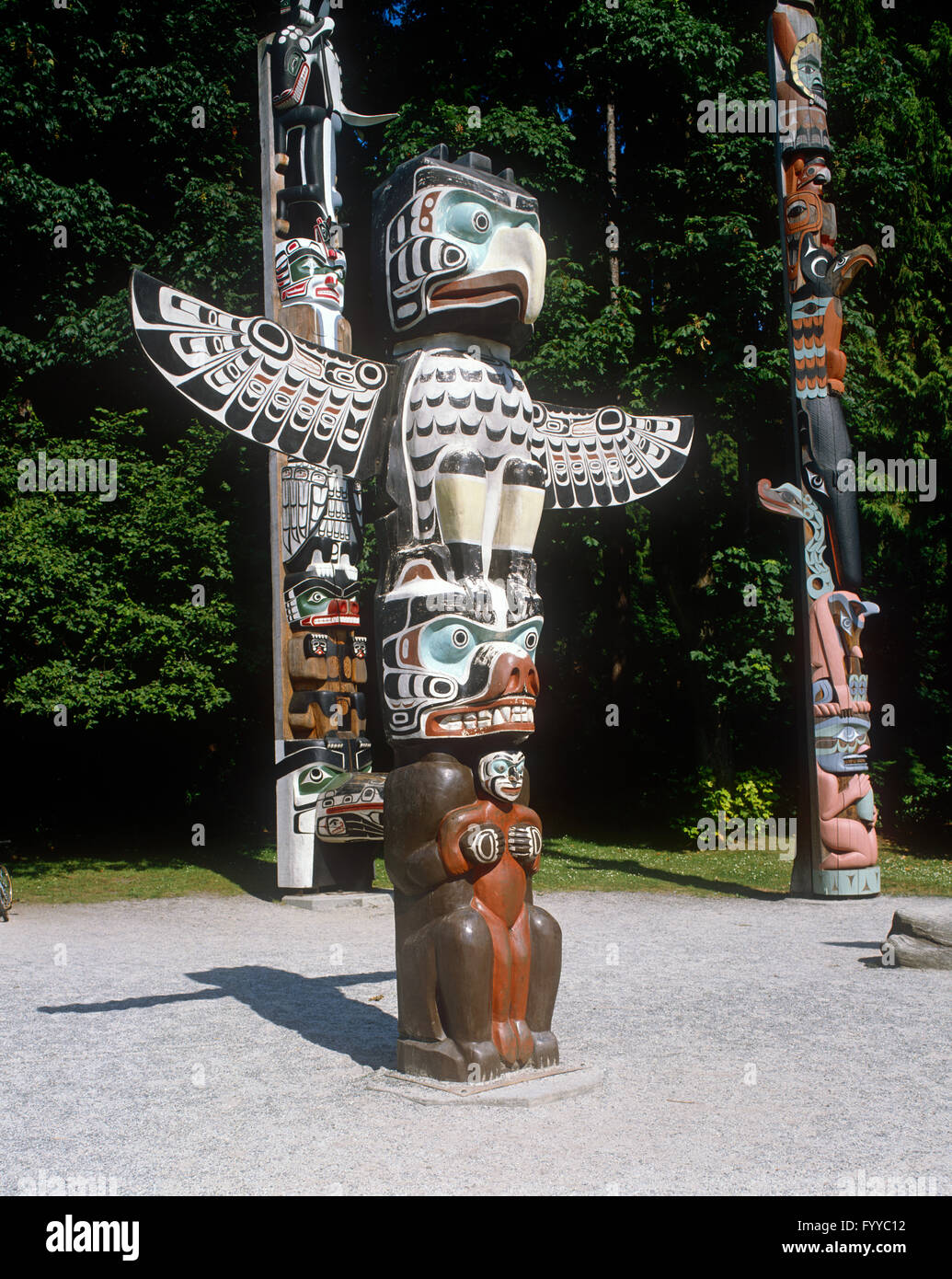 Red cedar wood Totem pole, outside. - Stock Image