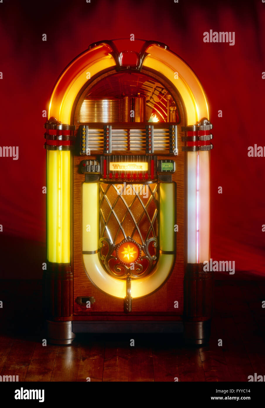 Wurlitzer Jukebox lit up, inside. - Stock Image