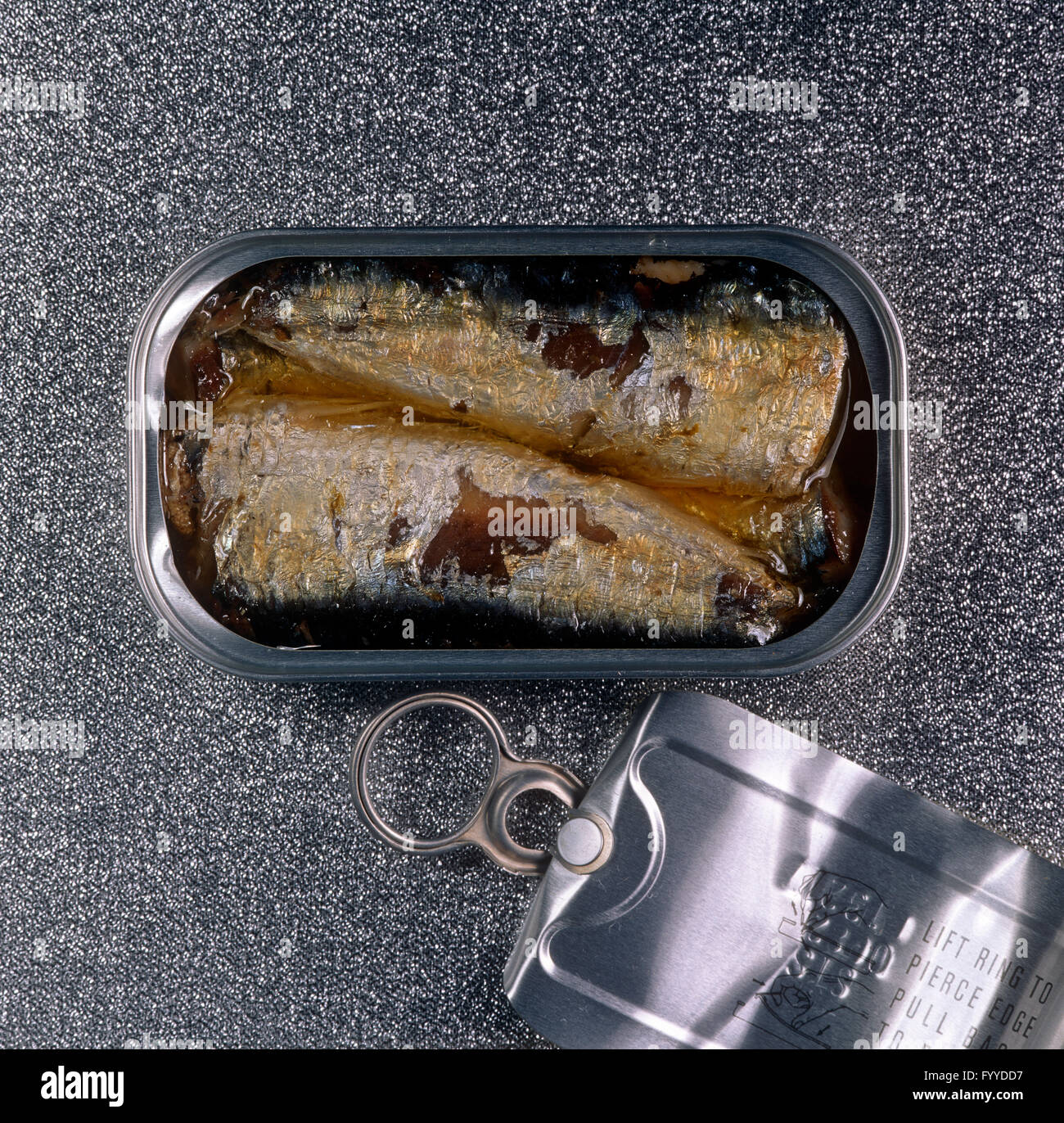 Fish in a tin, inside. - Stock Image