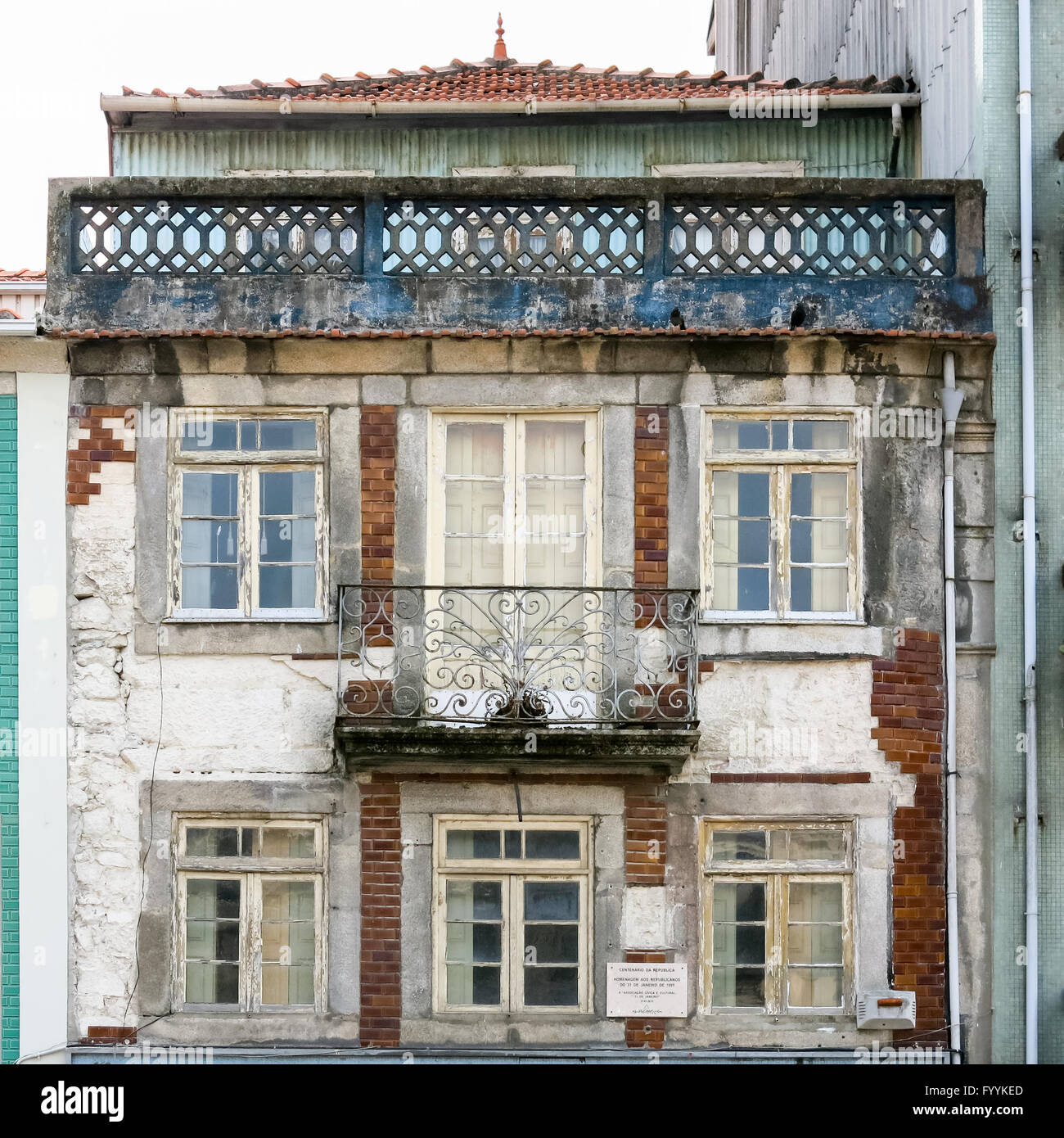 Facade of old deserted house in the city centre of Porto, Portugal - Stock Image