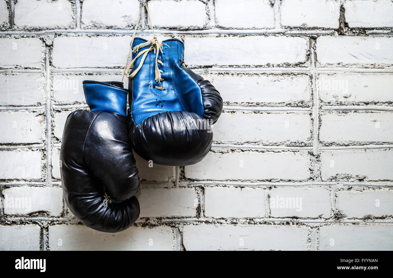 Boxing gloves on brick wall - Stock Image