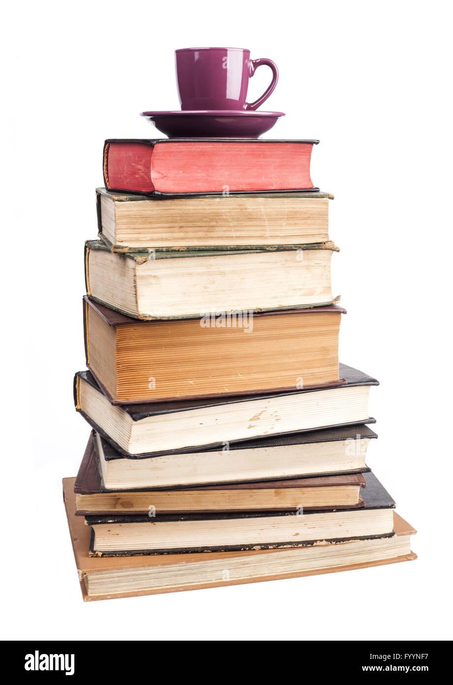 Purple Mug On Books - Stock Image