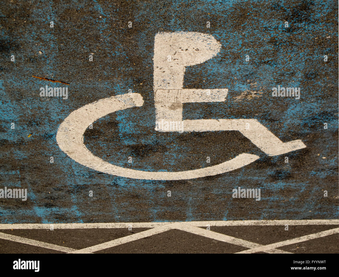 Disability parking sign  for motorists with road hatchings - Stock Image