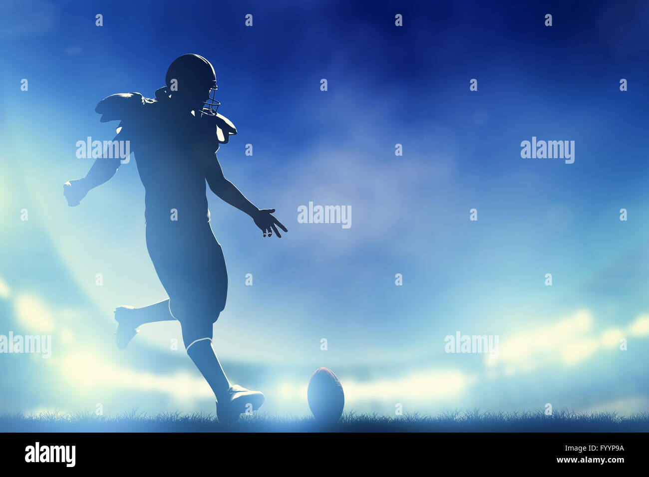 American football player kicking the ball - Stock Image