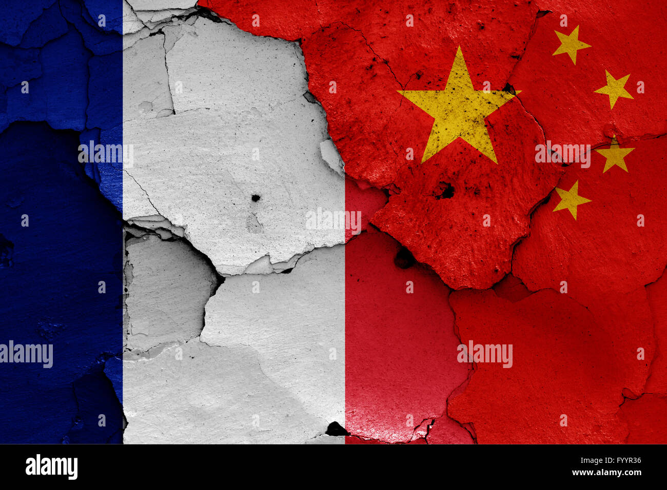 flags of France and China painted on cracked wall - Stock Image