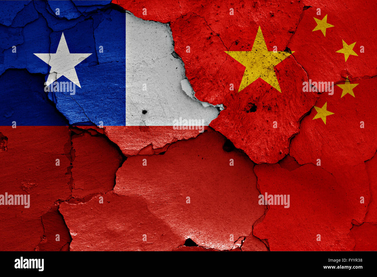 flags of Chile and China painted on cracked wall - Stock Image