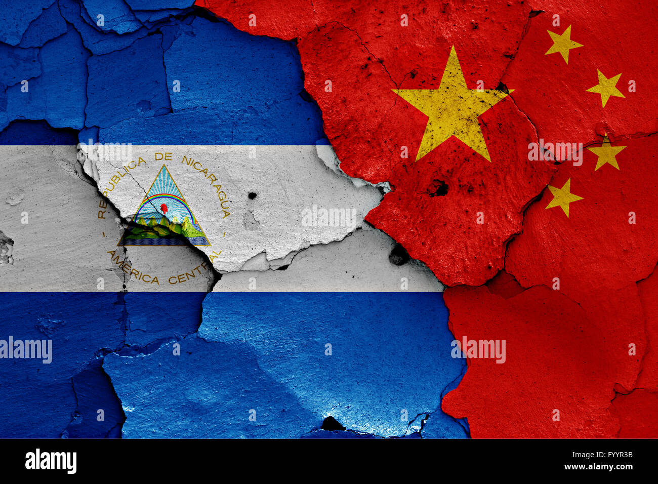 flags of Nicaragua and China painted on cracked wall - Stock Image