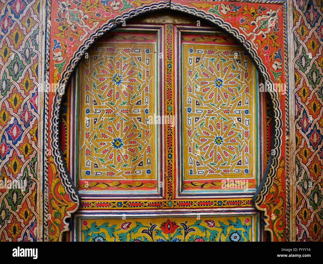 Traditional, intricately patterned, colourfully painted door in Fez, Morocco.The patterns are floral in red, yellow, Stock Photo
