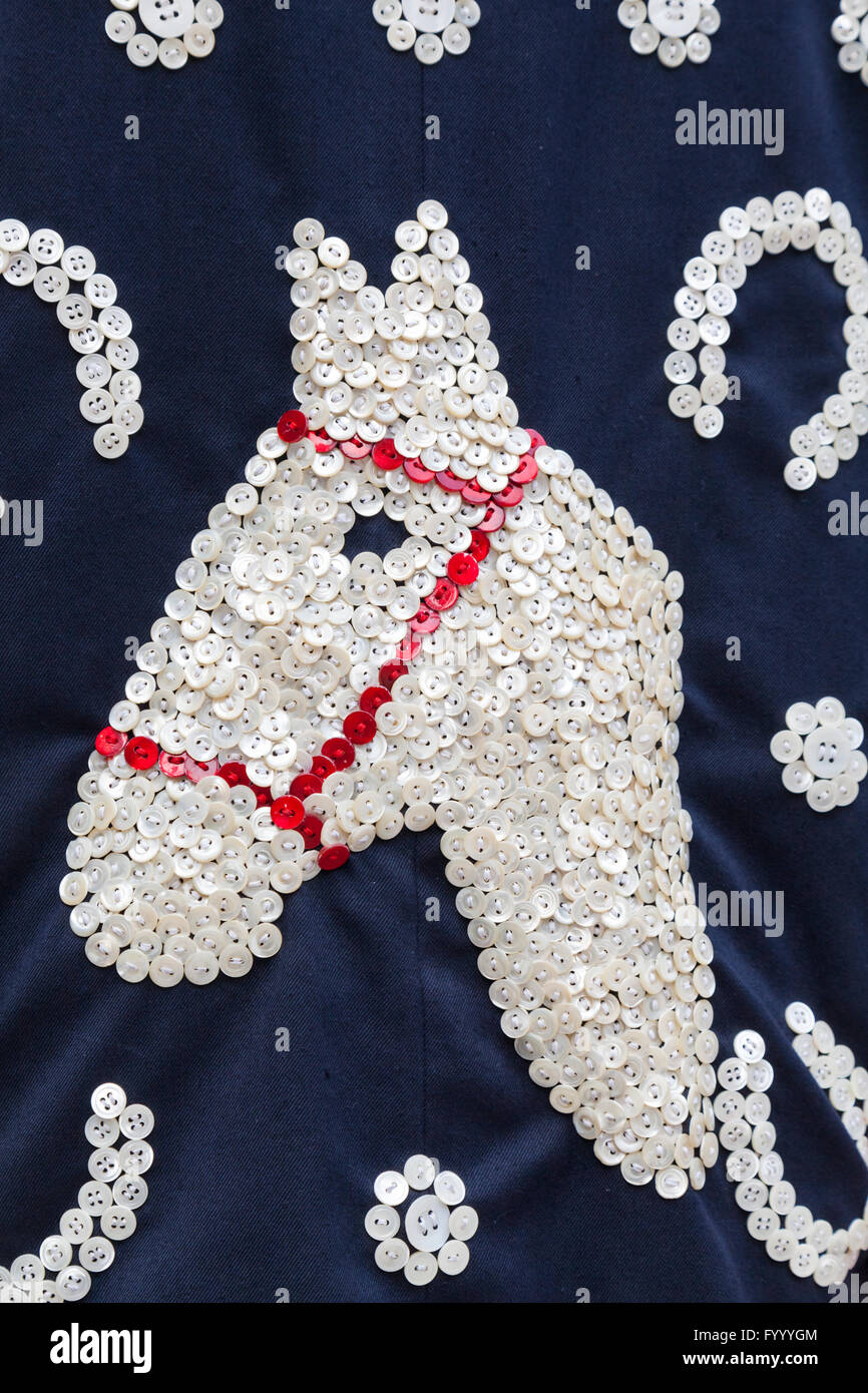 Hundreds of mother-of-pear buttons are sewn into a horse and horse shoe detail motif on the suit of John Scott, - Stock Image