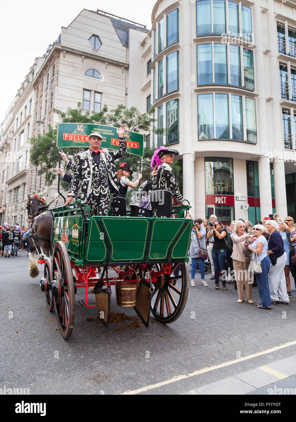 Shaun Austin, Pearly King of Tower Hamlets, waves from an old Fuller's brewery wagon, Pearly Kings and Queens - Stock Image
