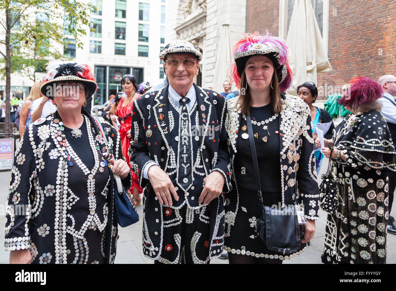 Pearly King and Queen of Crystal Palace, Carole (l) and Pat (m) Jolly, Nicola Marshall (r), Pearly Queen of Welwyn - Stock Image