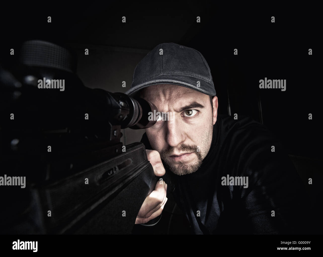 portrait of caucasian sniper with rifle - Stock Image