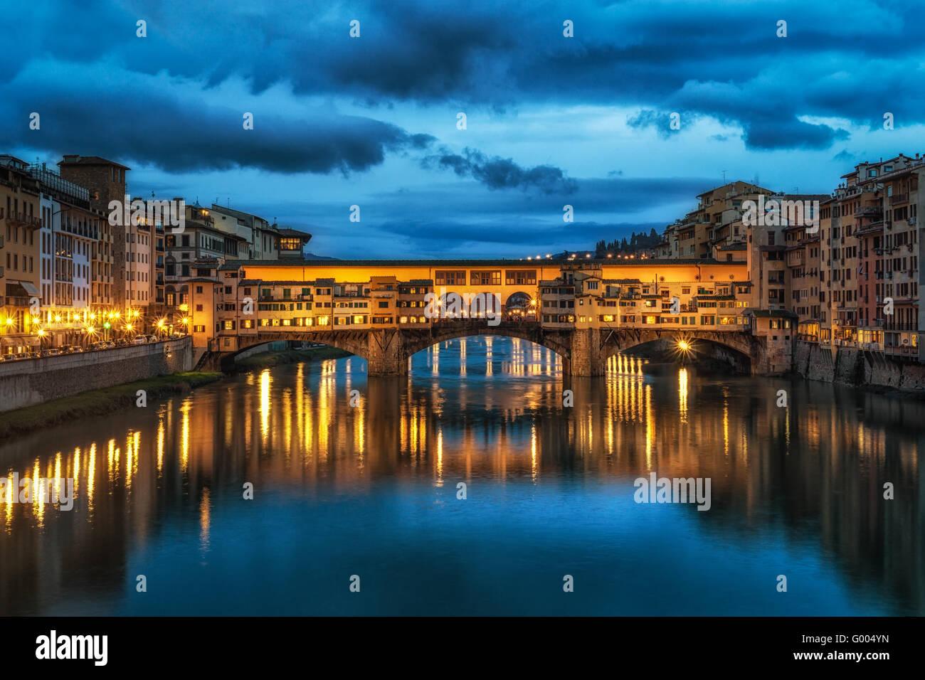 Night reflection of Ponte Vecchio - Stock Image