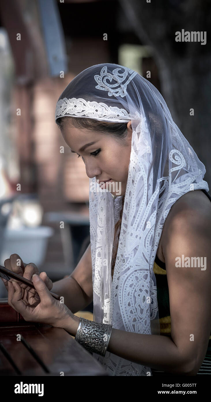 Asian beauty. Woman wearing a white veil. Thailand S. E. Asia. Asian beauty Stock Photo