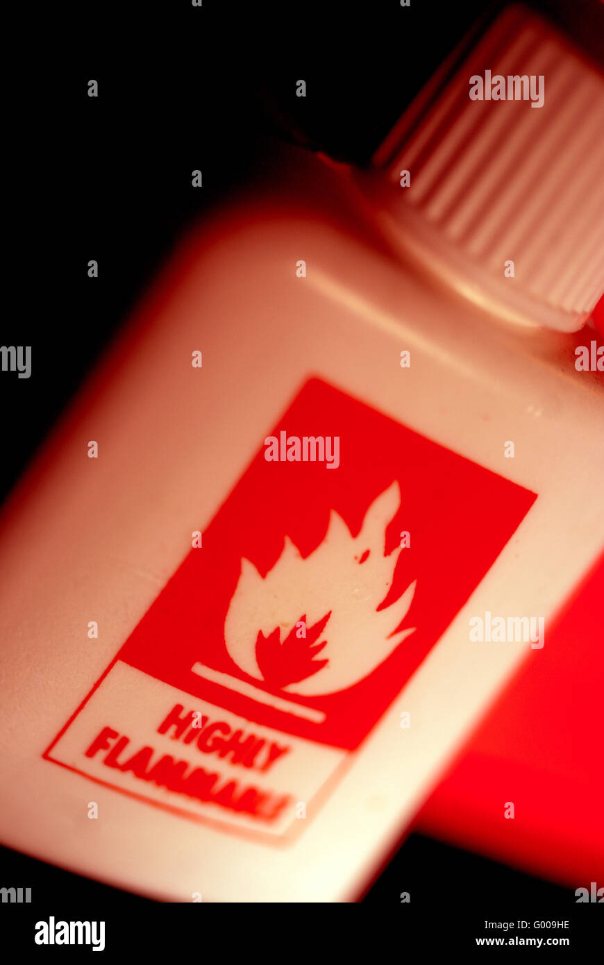 Highly Inflammable liquid in plastic bottle / Warning - Stock Image