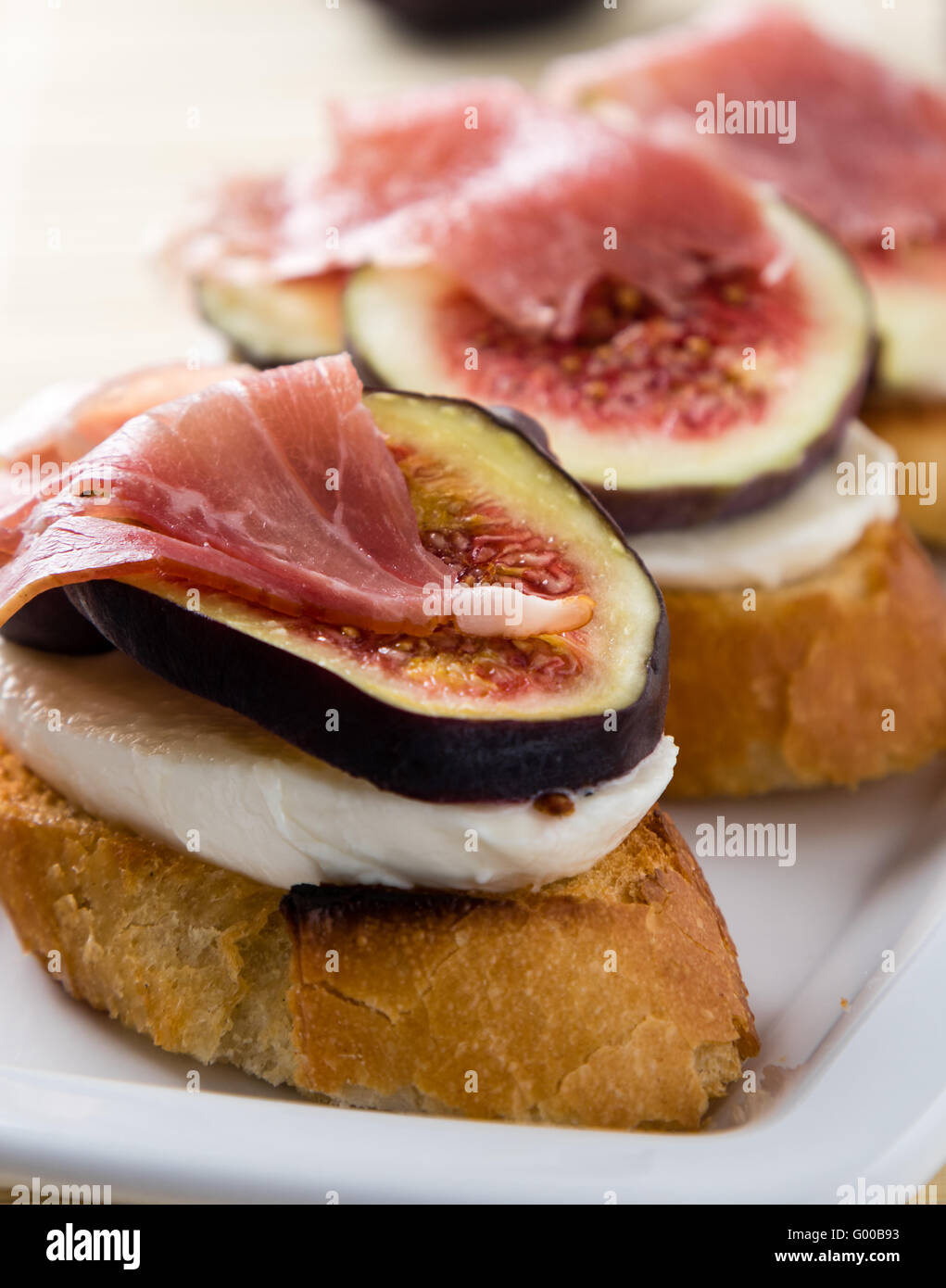 figs with cheese and prosciutto - Stock Image