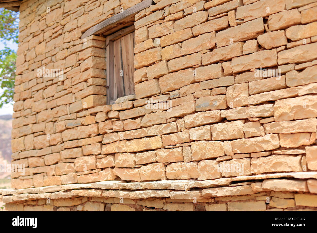 Dry stone wall-wooden window-building on the outer wall-compound of the Tewahedo-Ethiopian Orthodox Wukro Chirkos - Stock Image
