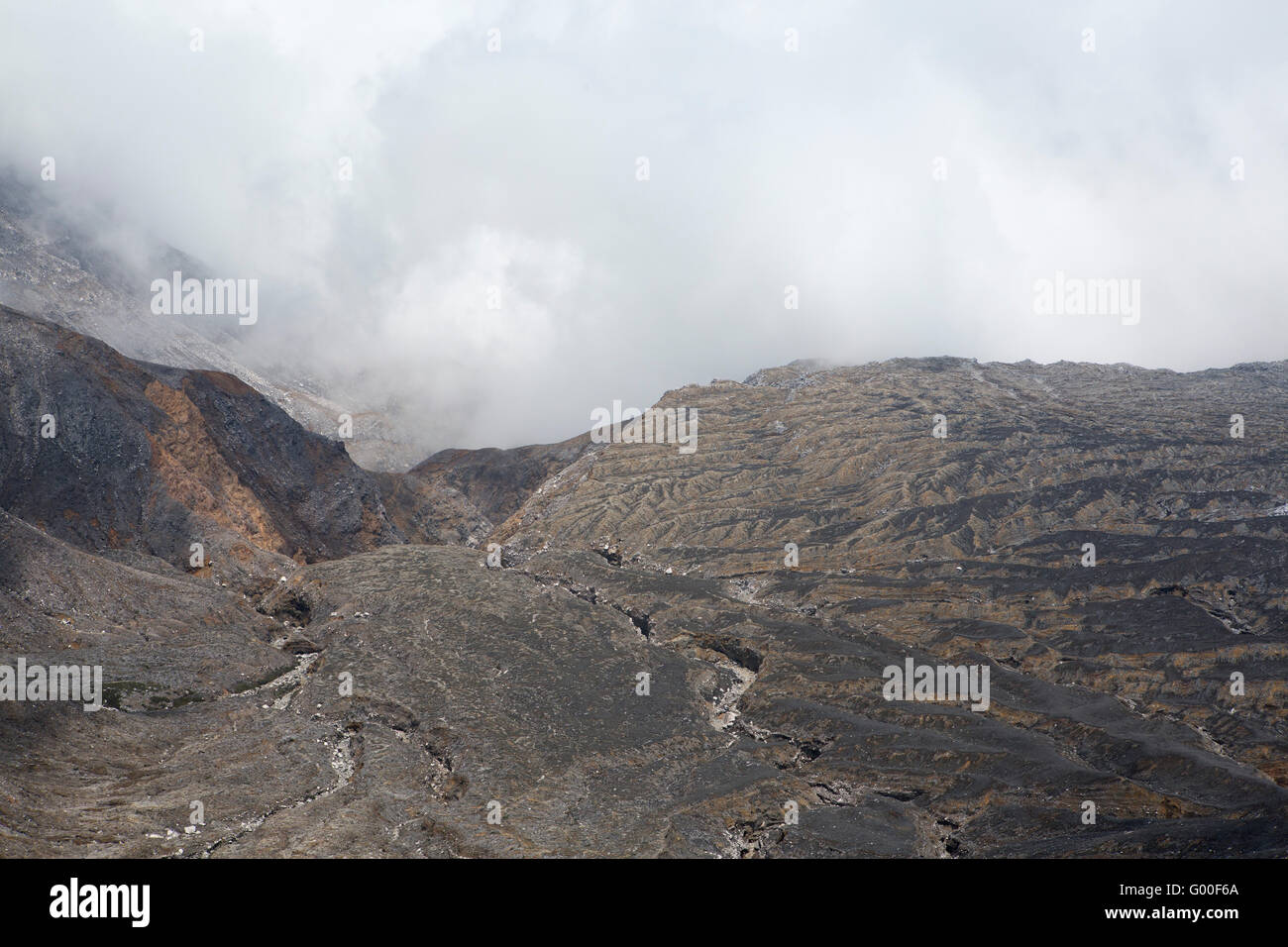 Rock and cloud at the crater of Poas Volcano in Parque Nacional Volcan Poas (Poas Volcano National Park) in Costa - Stock Image
