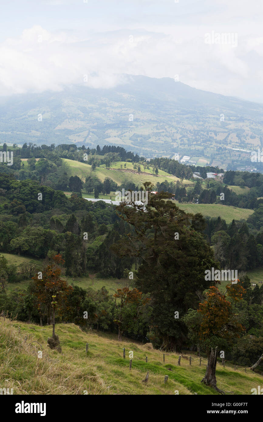Rolling farmland on the hillside beaneath the Poas Volcano in Costa Rica. - Stock Image