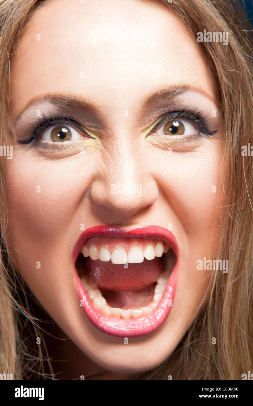 Angry woman screaming - Stock Image