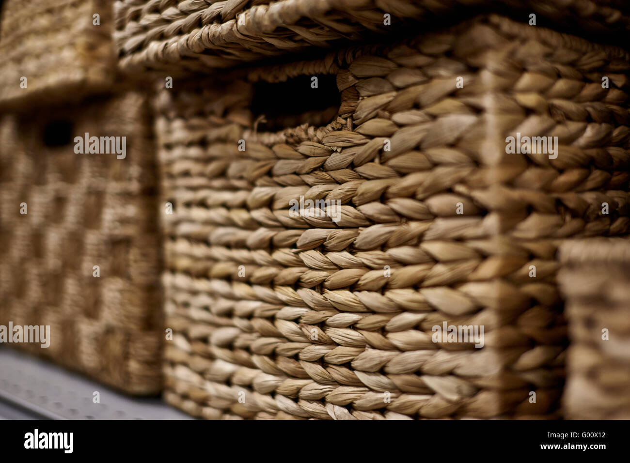 Stacks of natural fiber storage baskets in a rectangular shape with shallow depth of field & Stacks of natural fiber storage baskets in a rectangular shape with ...