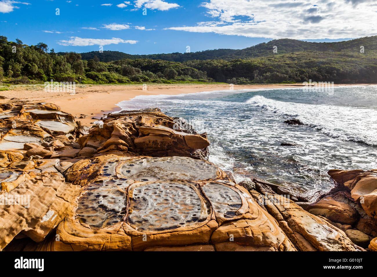 Australia, New South Wales, Central Coast, Bouddi National Park, beach and rock platform at Maitland Bay. - Stock Image