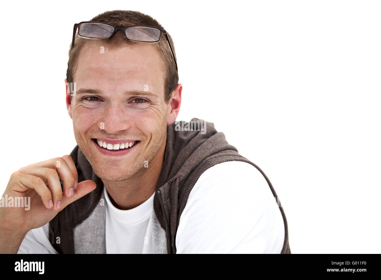 smiling young man with glasses - Stock Image